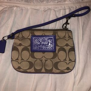 SUPER cute coach wristlet with purple detailing!